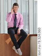 Купить «young business man talk by cellphone», фото № 9324060, снято 18 февраля 2020 г. (c) PantherMedia / Фотобанк Лори