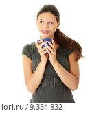 Купить «Businesswoman holding coffee cup», фото № 9334832, снято 21 июля 2019 г. (c) PantherMedia / Фотобанк Лори
