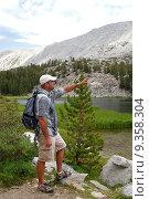 Купить «Hikers traverse the high country meadows of an alpine range», фото № 9358304, снято 23 мая 2019 г. (c) PantherMedia / Фотобанк Лори