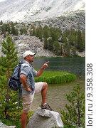 Купить «Hikers traverse the high country meadows of an alpine range», фото № 9358308, снято 23 мая 2019 г. (c) PantherMedia / Фотобанк Лори