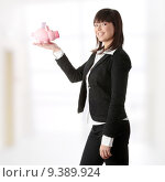 Купить «Woman Holding Piggy Bank», фото № 9389924, снято 20 февраля 2019 г. (c) PantherMedia / Фотобанк Лори
