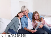 Купить «Senior woman with grandkids playing with touchpad», фото № 9589868, снято 21 ноября 2018 г. (c) PantherMedia / Фотобанк Лори
