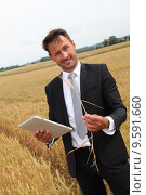 Купить «Businessman with electronic tablet standing in wheat field», фото № 9591660, снято 17 июля 2019 г. (c) PantherMedia / Фотобанк Лори