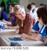 Купить «college students having a lecture in a classroom», фото № 9696520, снято 17 августа 2018 г. (c) PantherMedia / Фотобанк Лори
