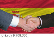 Купить «businessmen handshake after good deal in front of spain flag», фото № 9708336, снято 22 марта 2019 г. (c) PantherMedia / Фотобанк Лори