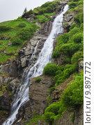 Купить «a beautiful waterfall on a mountain slope», фото № 9897772, снято 18 июня 2019 г. (c) PantherMedia / Фотобанк Лори
