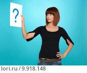 Купить «pretty young woman showing a question mark», фото № 9918148, снято 22 июля 2019 г. (c) PantherMedia / Фотобанк Лори