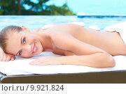 Купить «Beautiful woman lying on spa bed at outdoor», фото № 9921824, снято 25 июня 2019 г. (c) PantherMedia / Фотобанк Лори