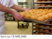 Купить «bakers in the bakery», фото № 9940840, снято 18 сентября 2018 г. (c) PantherMedia / Фотобанк Лори