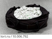 Купить «Image of big bag full of American dollars on the floor», фото № 10006792, снято 21 июля 2018 г. (c) PantherMedia / Фотобанк Лори