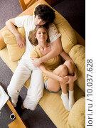 Купить «Over view of happy female on sofa being embraced by her boyfriend», фото № 10037628, снято 24 января 2019 г. (c) PantherMedia / Фотобанк Лори