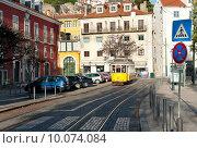 Купить «Желтый традиционный трамвай на улице в Лиссабоне, Португалия», фото № 10074084, снято 28 декабря 2013 г. (c) Татьяна Кахилл / Фотобанк Лори