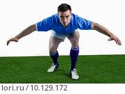 Купить «Rugby player ready to tackle the opponent», фото № 10129172, снято 6 мая 2015 г. (c) Wavebreak Media / Фотобанк Лори