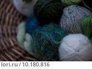 Купить «Close up of blue -green wools in basket», фото № 10180816, снято 21 мая 2019 г. (c) PantherMedia / Фотобанк Лори