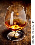 Купить «Glowing goblet of rich cognac», фото № 10238144, снято 20 июня 2019 г. (c) PantherMedia / Фотобанк Лори