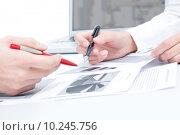 Купить «Close-up of people hands during discussion of business-plan », фото № 10245756, снято 16 июня 2019 г. (c) PantherMedia / Фотобанк Лори