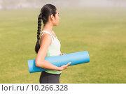 Купить «Sporty woman holding exercise mat», фото № 10266328, снято 20 мая 2015 г. (c) Wavebreak Media / Фотобанк Лори