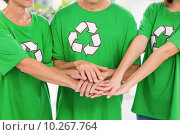 Eco-minded colleagues putting hands together. Стоковое фото, агентство Wavebreak Media / Фотобанк Лори