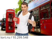 Купить «happy young man with backpack and book travelling», фото № 10299548, снято 8 апреля 2012 г. (c) Syda Productions / Фотобанк Лори