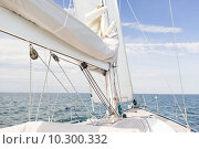 Купить «close up of sailboat mast or yacht sailing on sea», фото № 10300332, снято 13 июля 2014 г. (c) Syda Productions / Фотобанк Лори