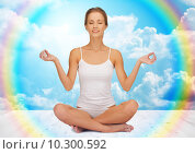 Купить «woman meditating in yoga lotus pose», фото № 10300592, снято 16 сентября 2012 г. (c) Syda Productions / Фотобанк Лори