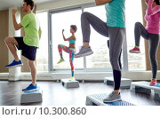 Купить «group of people raising legs on step platforms», фото № 10300860, снято 5 апреля 2015 г. (c) Syda Productions / Фотобанк Лори
