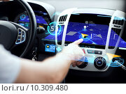 Купить «male hand using navigation system on car dashboard», фото № 10309480, снято 26 июня 2013 г. (c) Syda Productions / Фотобанк Лори