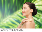 Купить «woman with soap over green palm leaf background», фото № 10309616, снято 6 января 2013 г. (c) Syda Productions / Фотобанк Лори