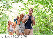 Купить «group of smiling friends with backpacks hiking», фото № 10310764, снято 25 июля 2015 г. (c) Syda Productions / Фотобанк Лори