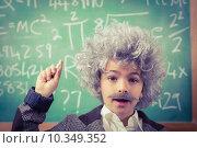 Купить «Little Einstein having an idea in front of chalkboard», фото № 10349352, снято 8 июля 2015 г. (c) Wavebreak Media / Фотобанк Лори