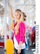 Купить «Pretty, young woman on a streetcar/tramway», фото № 10426532, снято 22 февраля 2020 г. (c) PantherMedia / Фотобанк Лори