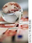 Купить «A globe and cash money closeup. », фото № 10429540, снято 23 марта 2019 г. (c) PantherMedia / Фотобанк Лори