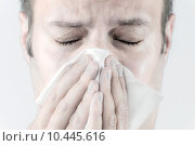 Купить «Ill man with tissue is sneezing», фото № 10445616, снято 27 мая 2018 г. (c) PantherMedia / Фотобанк Лори