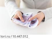 Купить «close up of woman hands counting euro money», фото № 10447012, снято 2 июля 2015 г. (c) Syda Productions / Фотобанк Лори