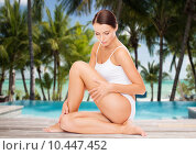Купить «beautiful woman touching her hips over beach», фото № 10447452, снято 25 июля 2013 г. (c) Syda Productions / Фотобанк Лори