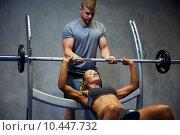 Купить «man and woman with barbell flexing muscles in gym», фото № 10447732, снято 19 апреля 2015 г. (c) Syda Productions / Фотобанк Лори