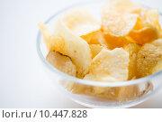 Купить «close up of crunchy potato crisps in glass bowl», фото № 10447828, снято 21 мая 2015 г. (c) Syda Productions / Фотобанк Лори