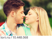smiling couple touching noses in park. Стоковое фото, фотограф Syda Productions / Фотобанк Лори