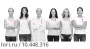 Купить «smiling women with pink cancer awareness ribbons», фото № 10448316, снято 31 марта 2012 г. (c) Syda Productions / Фотобанк Лори