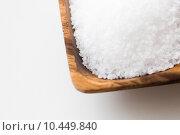 Купить «close up of white salt heap in wooden bowl», фото № 10449840, снято 22 мая 2015 г. (c) Syda Productions / Фотобанк Лори