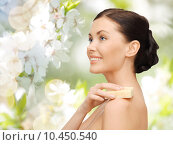 Купить «woman with soap bar over cherry blossom background», фото № 10450540, снято 6 января 2013 г. (c) Syda Productions / Фотобанк Лори