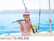 Купить «child little girl fishing in boat holding little tunny fish catc», фото № 10496836, снято 18 июня 2019 г. (c) PantherMedia / Фотобанк Лори
