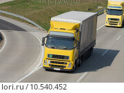 Купить «Yellow trucks roaring on the highway», фото № 10540452, снято 25 мая 2019 г. (c) PantherMedia / Фотобанк Лори