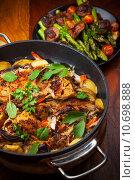 Купить «Roasted roasted rabbit on vegetables », фото № 10698888, снято 16 июля 2019 г. (c) PantherMedia / Фотобанк Лори