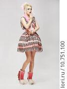 Купить «Fashion Style. Surprised Eccentric Woman in Trendy Dress. Amazement», фото № 10751100, снято 21 февраля 2018 г. (c) PantherMedia / Фотобанк Лори