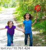 Купить «Friends and sister girls running in the forest track happy», фото № 10761424, снято 16 июля 2018 г. (c) PantherMedia / Фотобанк Лори
