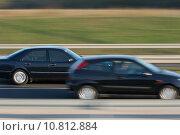 Купить «Fast car on a highway overtaking another one», фото № 10812884, снято 21 мая 2019 г. (c) PantherMedia / Фотобанк Лори