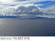 Купить «Rain cloud over ocean», фото № 10867916, снято 20 сентября 2019 г. (c) PantherMedia / Фотобанк Лори