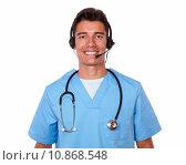 Купить «Handsome male nurse conversing on headphones», фото № 10868548, снято 24 января 2019 г. (c) PantherMedia / Фотобанк Лори