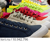 Купить «colored sports shoes, rubber and canvas», фото № 10942796, снято 23 октября 2019 г. (c) PantherMedia / Фотобанк Лори